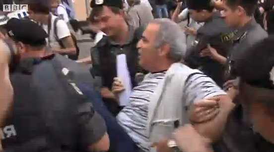 Police carrying Garry Kasparov, August 17, 2012