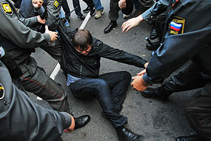 Detained protester. Source: ITAR-TASS