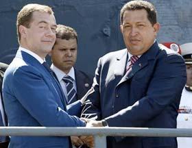 Dmitri Medvedev shakes hands with Hugo Chavez.  Source: Reuters