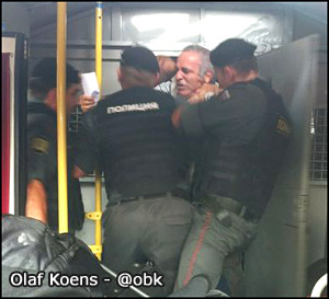Police throw Garry Kasparov into a paddy wagon on August 17, 2012