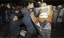 OMON riot police break up protest of deceased miner's relatives. Source: Andrei Lednev/AP