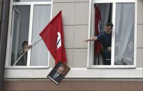 National Bolsheviks defenestrate Putin portrait.  Source: AP (c)