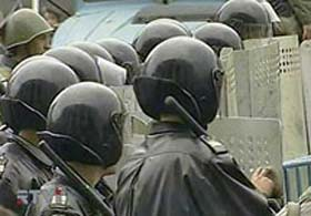 Omon riot police disperse demonstration.  source: newsru.com
