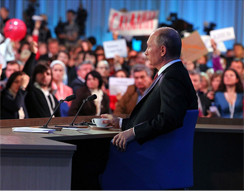 Putin with journalists. Source: ITAR-TASS