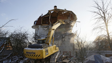 Demolition of a home in Rechnik. Source: RIA Novosti/Anton Denisov