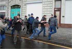 Activists running from plain-clothes police on December 12, 2009. Source: Kasparov.ru